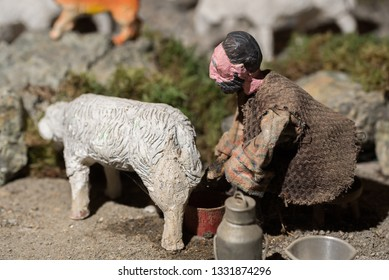 Riparbella Toscany Italy, December 2018. Miniature figurines of a peasant milking a sheep