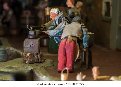 Riparbella Toscany Italy, December 2018. Miniature figurines of blacksmiths working