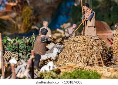 Riparbella Toscany Italy, December 2018. Miniature figurines of peasants gathering hay