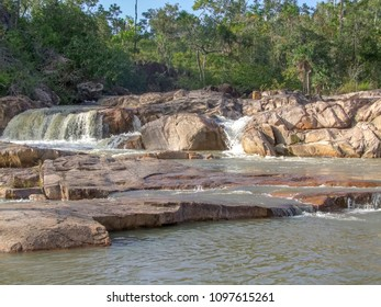 riparian scenery including some rock formations and a small cascade at Macal River in Belize in Central America