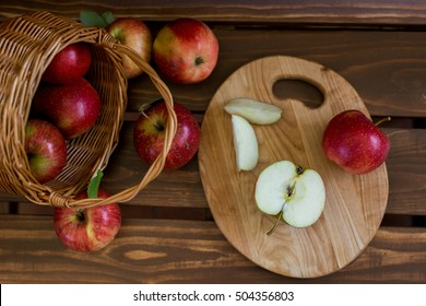 ripe Apple near the basket with apples
