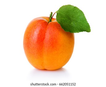 Ripe apricot fruit with green leaf isolated on white background
