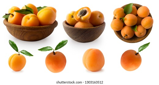Ripe apricots isolate on a white. Two bowls with apricots with leaves isolated on white background. Ripe apricots with copy space for text. Top view. Set of apricots.