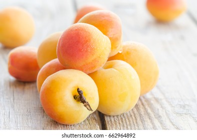 Ripe apricots on wooden table. close up