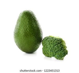 Ripe avocado and broccoli on white background