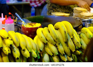 Ripe banana being prepared for Roti bread at a market festival in Thailand