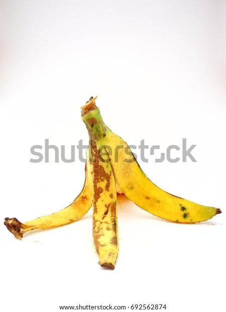 Ripe banana peel on white background