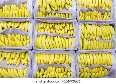 Ripe bananas in a box at the store. On showcase.