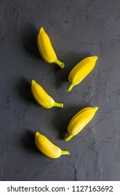 Ripe Bananas on black wall background.