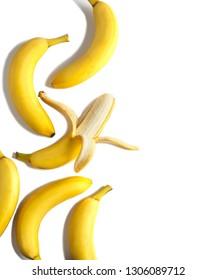 Ripe bananas on white background, flatlay, copy space