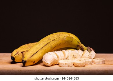 ripe bananas on wooden top