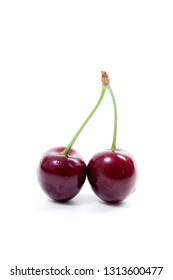 Ripe berries of red sweet cherry on a white background.