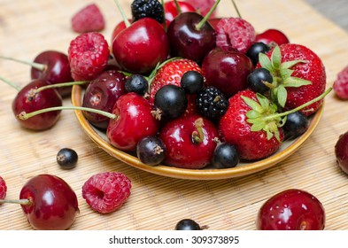 Ripe berry . Raspberry , strawberry , blackberry , mulberry , cherry, sweet cherry in drops  of water