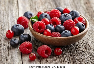 Ripe berry in a wooden plate
