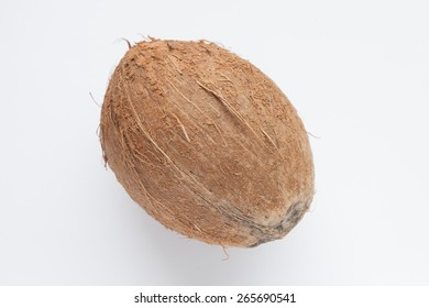 Ripe big coconut on white background