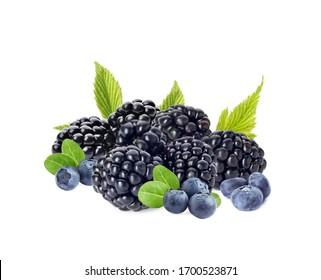 Ripe blackberries and blueberries on white background