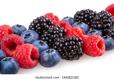 Ripe blackberries, blueberries and raspberries isolated on white background