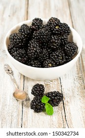 ripe blackberries on wooden background close-up