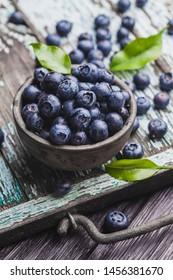 ripe blueberry berries on old wooden table. healthy food