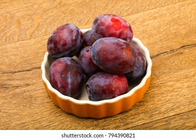 Ripe bright Plums in the bowl