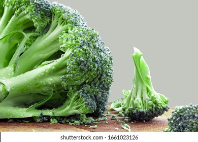Ripe broccoli cabbage lies on a wooden plate