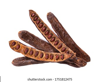 Ripe carob pods and bean isolated on white background. Top view.