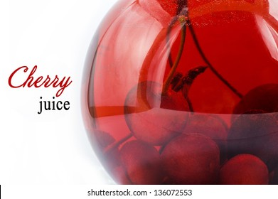 Ripe cherries in a Glass of cherry juice isolated on white