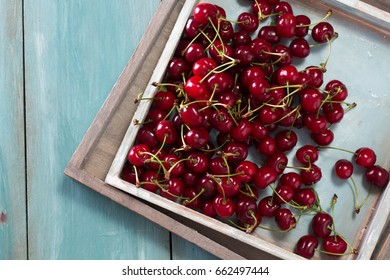 ripe Cherries on wooden table with water drops,fresh summer background