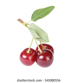 ripe cherries with stem and leaves, isolated on white