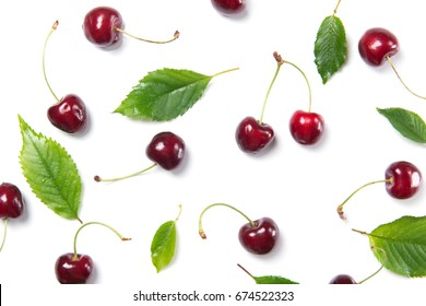Ripe cherry berries and cherry leaves pattern isolated on white background, top view
