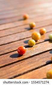 Ripe cherry tomatoes on rustic outdoor wood