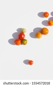 ripe cherry tomatoes on white background