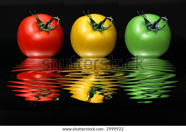 ripe  cherry-tomatoes  with water reflection