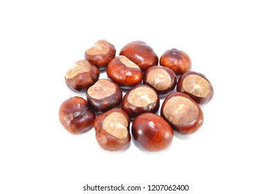 Ripe chestnuts on white background close-up