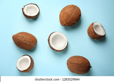 Ripe coconuts on color background