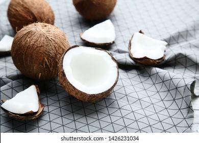 Ripe coconuts on grey napkin
