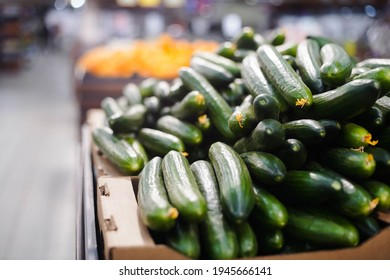 Ripe cucumbers at the grocery store. Vegetables are on the shelf at the farmers' market. - Shutterstock ID 1945666141