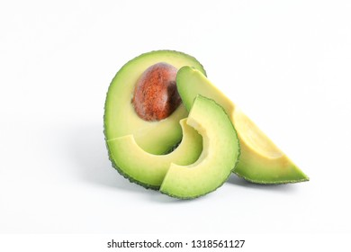 Ripe cut avocado on white background, space for text