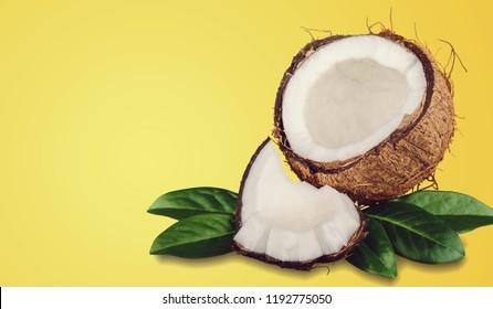 Ripe cut coconut composition on beach