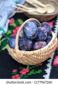 Ripe damson plums in a basket