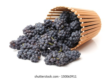Ripe dark grapes on white background