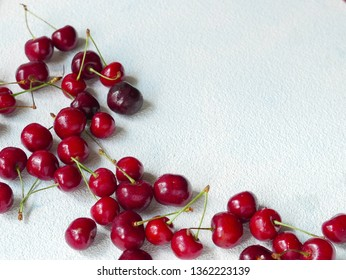 Ripe delicious cherries on the white tablecloch whit the copy space
