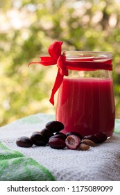 Ripe dogwood berries, drink in a glass jar