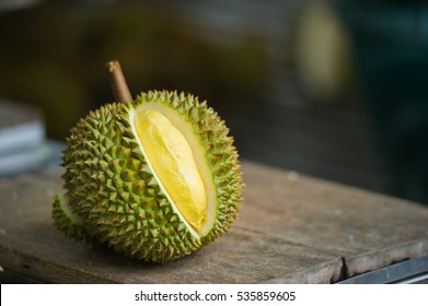 Ripe durian on table under tree shadow in the garden background.Durian is the fruit of several tree species belonging to the genus Durio. Durian taste is combination of  sweet and creamy all at once.