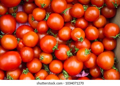 Ripe early spring bright red tomatoes background texture