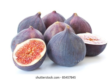 ripe figs cut in on a white background