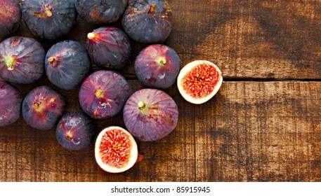 Ripe figs on rustic wooden table