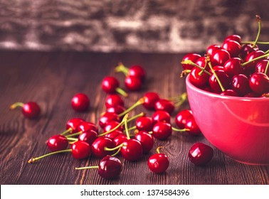 ripe fresh cherries in the bowl close-up. background with cherry berries.