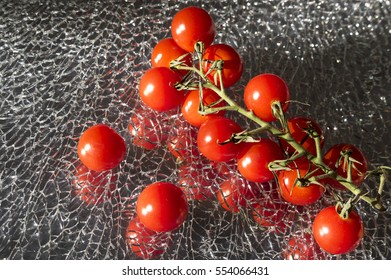 Ripe Fresh Cherry Tomatoes Branch on Broken Mirror Glass