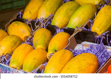 Ripe fresh fruits of a papaya in boxes on a show-window of the farmer market